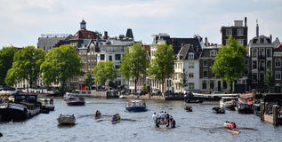 Boats in Amsterdam. People on boats in Amsterdam, Netherlands, in spring Stock Images