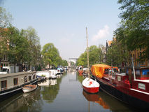 Boats in Amsterdams canal. Holland Royalty Free Stock Photography