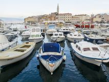 Boats anchered in Rovinj Marina and the Old Town with Basilica of St. Euphemia at the top 0902 Royalty Free Stock Photography