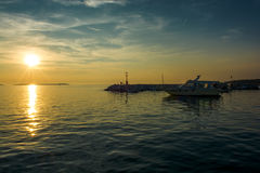 Boats Anchor on Jetty in Croatia at Sunset Royalty Free Stock Images