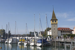 Boats at anchor in Lindau Harbour. Royalty Free Stock Image