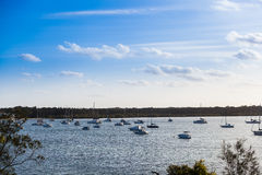 Boats at anchor. Many boats at anchor in Nelsons bay. This is a popular holiday destination in Australia only a few hours north of Sydney stock photos