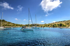 Boats on anchor. Sandy beach with boats - Kornati Royalty Free Stock Images