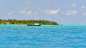 Boats anchored along tropical islands Stock Images