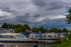 Boats anchored on the bank of the river, residential houses on t Royalty Free Stock Photography