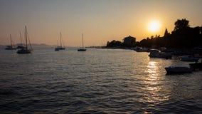 Boats anchored in a bay near Zadar, croatia at sunset stock image