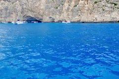 Ionian Sea. Boats anchored in Navagio Bay - Zakynthos Island, Greece. Seascape Royalty Free Stock Photos
