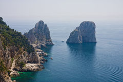 Boats Anchored by Capri Rocks Royalty Free Stock Photos