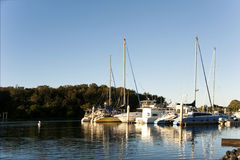Boats anchored on a clear day Stock Images