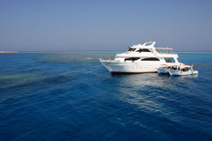 Boats anchored on coral reef Stock Photo