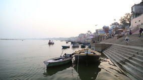 Boats anchored on the ghats of Ganges river in Varanasi. stock video