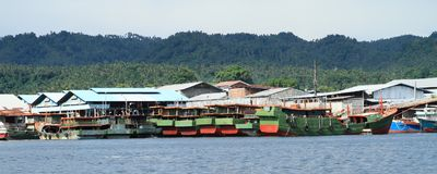 Boats anchored in harbor in Bitung. Ships harbored in a port in Lembeh Strait in Bitung, North Sulawesi, Indonesia Stock Image