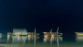 Boats anchored near the shores of Zanzibar Stock Photos