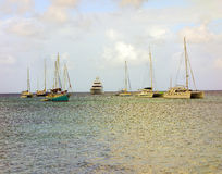 Boats anchored off princess margaret beach in the grenadines Royalty Free Stock Photo