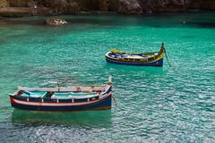 Boats anchored at Popeyes village. Boats anchored at Popeye`s village in Malta island over clear blue water Stock Photos