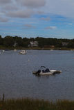 Boats anchored in a quaint Cape Cod waterway Royalty Free Stock Photos