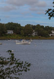 Boats anchored in a quaint Cape Cod waterway Stock Image
