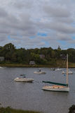 Boats anchored in a quaint Cape Cod waterway Stock Photos