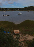 Boats anchored in a quaint Cape Cod waterway Royalty Free Stock Images