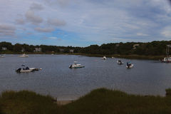 Boats anchored in a quaint Cape Cod waterway Stock Photo