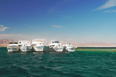 Boats anchored on Red Sea coral reef Royalty Free Stock Photography