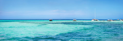 Boats anchored by the sand bar Stock Images