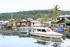 Boats anchored by fishermen village in Manokwari stock photos
