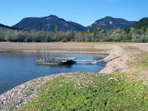 Boats anchored at shore of Liptovska Mara Lake royalty free stock images