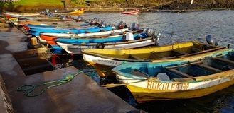 Boats anchored in the port of Hanga Roa on Easter Island, Chile royalty free stock photos