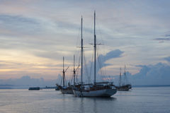 Boats Anchored in Sorong Harbor at Sunrise Royalty Free Stock Images