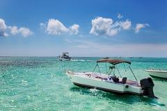 Boats anchored at Stingray City. Boats anchored by the sandbar at Stingray City, Grand Cayman royalty free stock photo
