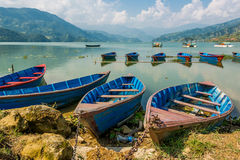 Boats anchored to a shore. Lake Phewa in Pokhara, Nepal Stock Images