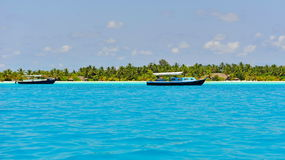 Boats anchored in tropical sea of Maldives Stock Image