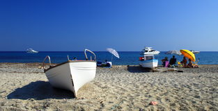 Free Boats And People On The Beach Royalty Free Stock Image - 3040896