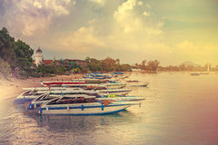 Boats in the Andaman Sea. Speedboat on the pier for traveling around the island. Thailand. Retro style filter. Instagram toning effect Royalty Free Stock Photo