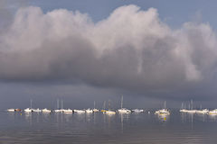 Boats at Andernos-les-bains in France. Boats on the sea under big clouds at port of Bétey at Andernos-les-bains, ostreicole commune located on the northeast stock image