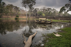 Boats at Angkor Thom. These boats are in the outer moat of Angkor Thom Cambodia. I assume they are either for tourists or some sort of pageant or display that stock images