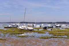Boats at Arès in France. Boats at low tide at Arès, ostreicole commune located on shore of Arcachon Bay, in the Gironde department in southwestern France Royalty Free Stock Photo