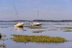 Boats at Arès in France. Sailboats at low tide at Arès, ostreicole commune located on shore of Arcachon Bay, in the Gironde department in southwestern Stock Photo