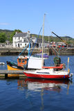 Boats in Ardrishaig harbor, Argyll, Scotland. View of a yacht and a small boat moored at a wooden jetty in Ardrishaig harbour on Loch Gilp (off Loch Fyne) near Stock Images