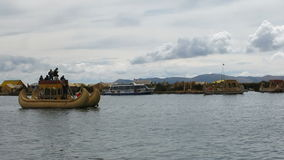Boats around Uros Floating Island In Lake Titicaca stock footage