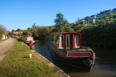 Boats on Avaon canal near Bath. Couple of parked houseboat on the canal of river Avon beside the footwalk near Bath, England, UK Royalty Free Stock Photo