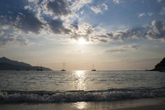 Panorama by Scaglieri beach. On Elba Island, Italy. Boats in the backlight in the marine sunset. Beautiful seascape of Scaglieri beach. This place is located on royalty free stock images