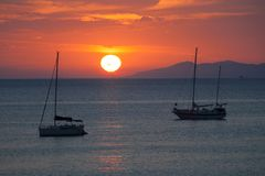 Panorama by Scaglieri beach. On Elba Island, Italy. Boats in the backlight in the marine sunset. Beautiful seascape of Scaglieri beach. This place is located on royalty free stock photography