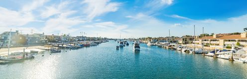 Boats in Balboa island harbor on a sunny day. Newport Beach, Orange County. Southern California, USA stock images