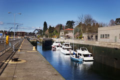 Boats in Ballard Locks. (looking upstream) water level at the bottom and the lock opening to the lake Royalty Free Stock Image