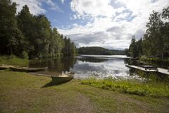 Boats on the bank of the forest lake. Finland Stock Image