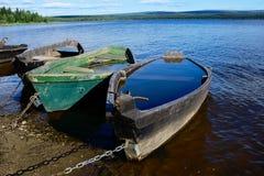 Boats on bank of lake Royalty Free Stock Photos