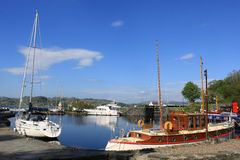 Boats in basin, Crinan canal, Argyll and Bute. Various boats moored in the canal basin at the western end of the Crinan canal, Argyll and Bute, Scotland Royalty Free Stock Image