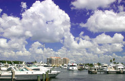 Boats on the Bay. Boats on Sarasota Bay, Florida, with condo and cloudy sky in background stock photos